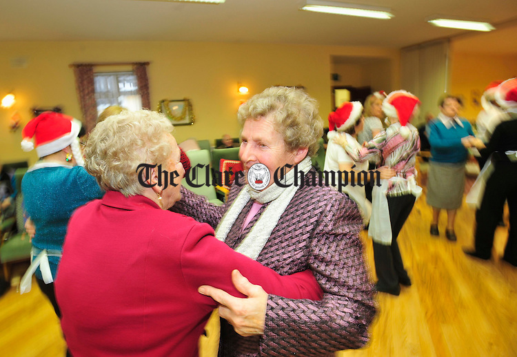 Kitty Harkin and Noreen Liddy enjoy a waltz during Christmas celebrations at the District Day Centre in Clarecastle. Photograph by Declan Monaghan