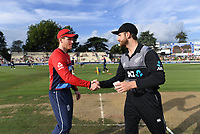 Kane Williamson and Eoin Morgan shake hands after the coin toss. New Zealand Black Caps v England.Tri-Series International Twenty20 cricket. Eden Park, Auckland, New Zealand. Sunday 18 February 2018. © Copyright Photo: Andrew Cornaga / www.Photosport.nz