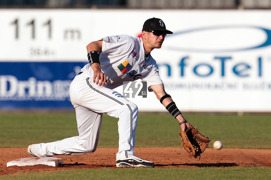 06 June 2010: Second base Martin Schneider of AVG Draci Brno eyes the ball during the 2010 Baseball European Cup match won 10-8 by the Rouen Huskies over AVG Draci Brno, at the AVG Arena, in Brno, Czech Republic.