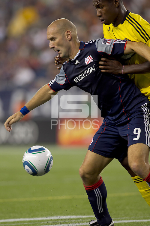 New England Revolution forward Ilija Stolica (9) attempts to control the ball while being pressured. The New England Revolution tied Columbus Crew, 2-2, at Gillette Stadium on September 25, 2010.