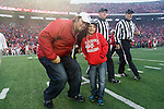 Wisconsin Badgers honorary captain Mark Tauscher with the honorary junior captain prior to an NCAA Big Ten Conference Football game against the Indiana Hoosiers Saturday, November 16, 2013, in Madison, Wis. The Badgers won 51-3. (Photo by David Stluka)