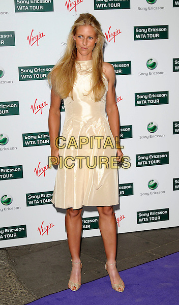 ELENA DEMENTIEVA .The WTA Tour Pre-Wimbledon Party, Kensington Roof Gardens, London, England. .June 18th, 2009 .full length white gold cream dress shoes.CAP/CAN.©Can Nguyen/Capital Pictures.