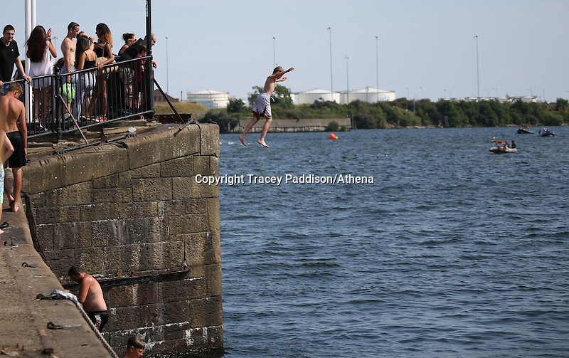 Saturday July 26th 2014 <br /> Pictured: Cardiff Bay <br /> RE: Boy jumps into the water at Cardiff Bay during the heat wave
