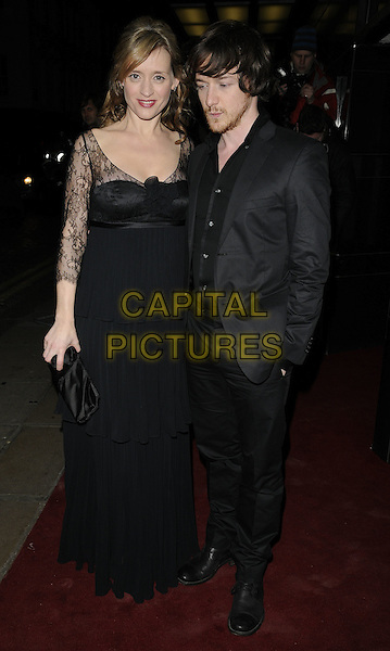 ANNE MARIE DUFF & JAMES McAVOY .The UK Premiere of 'The Last Station' at The Curzon Mayfair Cinema, London, England..January 26th 2010.full length black jacket dress lace clutch bag married husband wife beard facial hair maxi suit hand in pocket looking down.CAP/CAN.©Can Nguyen/Capital Pictures.
