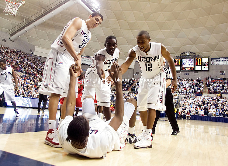 STORRS, CT- 08 JANUARY 2008- 010808JT06-<br /> UConn's Hasheem Thabeet is helped off the floor after falling by teammates Gavin Edwards, Doug Wiggins, and A. J. Price during Tuesday's game against St. John's in Storrs. UConn won 81-65.<br /> Josalee Thrift / Republican-American