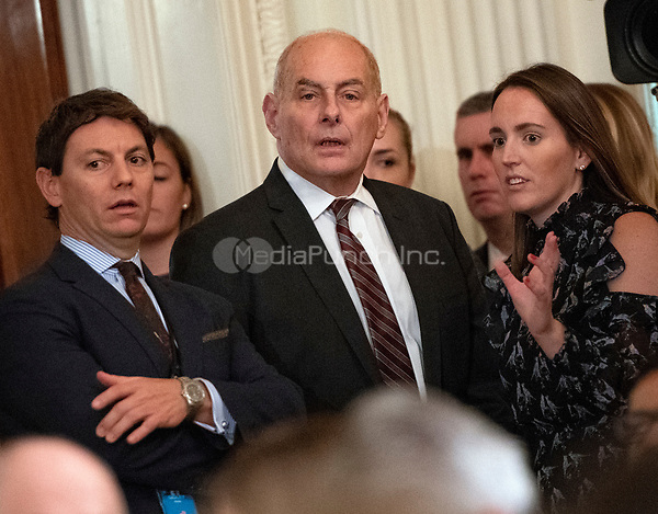 White House Chief of Staff John Kelly, center, with White House Deputy Press Secretary Hogan Gidley, left, and White House Deputy Press Secretary Lindsay Walters, right, prior to the arrival of United States President Donald J. Trump, who will hold a press conference in the East Room of the White House in Washington, DC on Wednesday, November 7, 2018.<br /> Credit: Ron Sachs / CNP/MediaPunch<br /> (RESTRICTION: NO New York or New Jersey Newspapers or newspapers within a 75 mile radius of New York City)