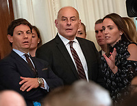 White House Chief of Staff John Kelly, center, with White House Deputy Press Secretary Hogan Gidley, left, and White House Deputy Press Secretary Lindsay Walters, right, prior to the arrival of United States President Donald J. Trump, who will hold a press conference in the East Room of the White House in Washington, DC on Wednesday, November 7, 2018.<br />