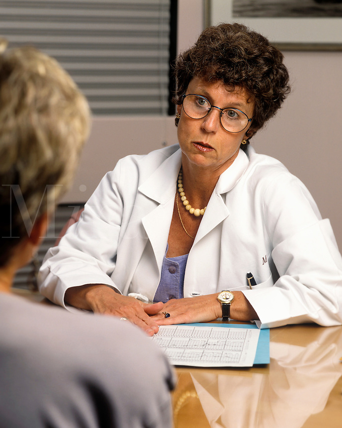 Female doctor in discussion with patient.