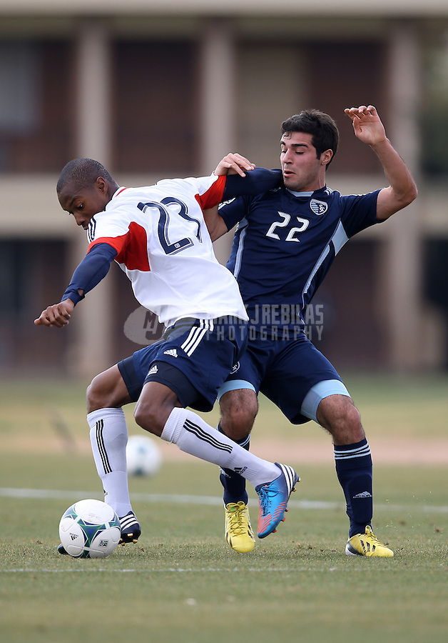 Jan. 25, 2013; Casa Grande, AZ, USA: New England Revolution defender Jose Goncalves (left) battles Sporting KC forward Soony Saad during a preseason game at Grande Sports World. Mandatory Credit: Mark J. Rebilas-USA TODAY Sports