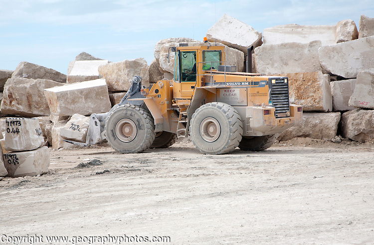 Heavy machinery in a working quarry, Isle of Portland, Dorset, England