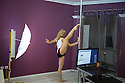 "Romania - Timisoara - Kendra Blu performing in a gymnastic pose in her room. Kendra Blu, 24, from Timisoara, has been a camgirl for the past 19 months. A former rising star in gymnastics, Kendra was forced to give up when she was 12, after a serious back injury ruined her dream to join the Olympic team at Beijing 2008. Despite making between 1,000 and 3,000 USD per month, Kendra is still not totally used to the idea of undressing and performing in front of the webcam. ""My first week was a horror. When I had my first private show, I was almost crying"" she says. Although the money she earns allows her to support her parents and boyfriend, she doesn't plan to tell her mother and father about her job. ""They would never understand"", she says."