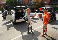 NWA Democrat-Gazette/ANDY SHUPE<br /> Mikel Lolley (right), co-founder of Sustainable Urban Mobility, speaks with Fayetteville resident Deborah Bird Saturday, Sept. 19, 2015, about his business and fleet of electric cars during the first electric vehicle rally in downtown Fayetteville. Northwest Arkansas electric vehicle dealers and service providers gathered to give residents a chance to experience and drive the variety of electric vehicles that are available before taking part in a parade through downtown and the entertainment district as a local participation of National Drive Electric Week.