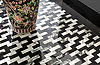 Ziggurat Grand, a stone hand-cut mosaic, shown in polished Plumeria and Nero Marquina, is part of the Tissé® collection for New Ravenna.