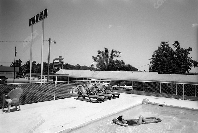 Route 66: Women and girls at Munger Moss Motel swimming pool in Lebanon, MO.