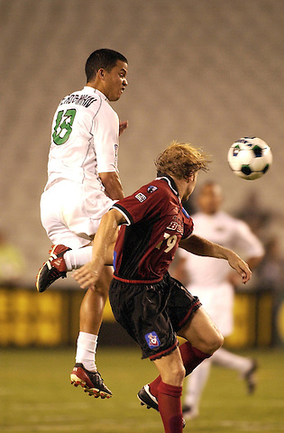 DALLAS, TX -OCTOBER 2: Bobby Rhine #19 of the Dallas Burn heads the ball away from Steven Herdsman #18 of Colorado Rapids at Cotton Bowl in Dallas on October 2, 2002 in Dallas, Texas. (Photo by Rick Yeatts) Rhine's career consisted of 212 games making 136 starts, played more than 12,000 minutes scoring 23 goals and 34 recorded assists.