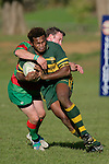 S. Lutumailagi is tackled by Waiuku secondfive P. Baird. Counties Manukau Premier Club Rugby, Pukekohe v Waiuku  played at the Colin Lawrie field, on the 3rd of 2006.Pukekohe won 36 - 14