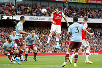 Sokratis Papastathopoulos of Arsenal heading the ball during the Premier League match between Arsenal and Aston Villa at the Emirates Stadium, London, England on 22 September 2019. Photo by Carlton Myrie / PRiME Media Images.