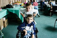Corey Knotts, seated, and his brother at the Share and Care Network's annual retreat held in Montauk, NY on March 18, 2003.
