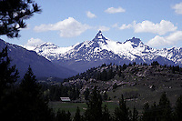 Pilot and Index Peaks as seen from the Hancock Ranch. These peaks are the most recognized, even iconic features of the North Absaroka Wilderness. This big wilderness area protects much of the northern part of Wyoming's Absaroka Range, a high and intricately eroded landscape of ancient volcanic debris. The wilderness adjoins the northeastern boundary of Yellowstone National Park for many miles.