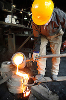 "Filling a cast with molten iron, Oigen ""Nambu Tekki"" ironware foundry, Esashi, Iwate Prefecture, Japan, August 28 2008."