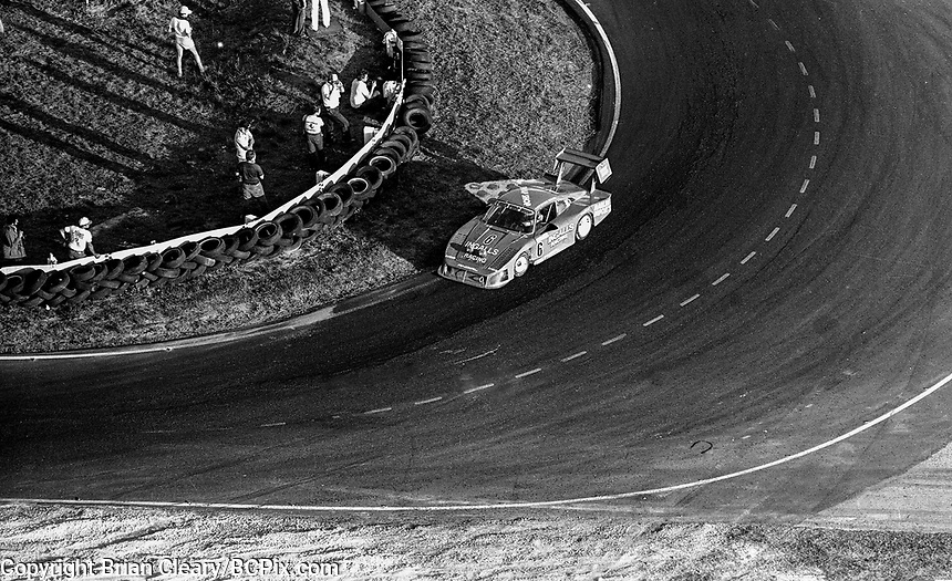 #6 Porsche 935 of Derek Bell, A.J. Foyt, and Bob Wollek, aerial view from Goodyear blimp, 3rd place,  hairpin turn, 12 Hours of Sebring, IMSA Camel GT race, Sebring International Raceway, Sebring, Florida, March 24, 1984.  (Photo by Brian Cleary/www.bcpix.com)