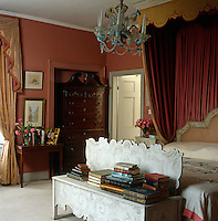 The bed and half tester in the master bedroom were designed by Thomas Messel and the chandelier is Venetian glass