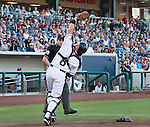 Reno Aces catcher Ryan Budde makes the play on a popup as home plate umpire Joel Hospodka look on agianst the Colorado Sky Sox during their game on Friday night July 27, 2012 at Aces Ballpark in Reno, NV.