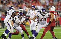 Dec 6, 2009; Glendale, AZ, USA; Minnesota Vikings quarterback (4) Brett Favre throws a pass as he is protected by guard (76) Steve Hutchinson and tackle (74) Bryant McKinnie against the Arizona Cardinals at University of Phoenix Stadium. The Cardinals defeated the Vikings 30-17. Mandatory Credit: Mark J. Rebilas-