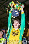 The Gneeveguilla captain Don Murphy holding up the Castleisland Mart Intermediate Football Cup..