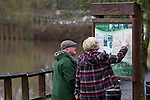 Pix: Shaun Flannery/shaunflanneryphotography.com...COPYRIGHT PICTURE>>SHAUN FLANNERY>01302-570814>>07778315553>>..5th February 2011...........A couple read the Trans Pennine Trail route map at Sprotbrough Lock, Doncaster.