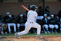 Center fielder Erik Samples (1) of the University of South Carolina Upstate Spartans bats in a game against the UNC Asheville Bulldogs on Tuesday, March, 25, 2014, at Cleveland S. Harley Park in Spartanburg, South Carolina. (Tom Priddy/Four Seam Images)
