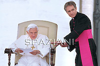 Pope Benedict XVI waves as he leaves his weekly general audience on May 5, 2010 at St Peter's square at The Vatican.
