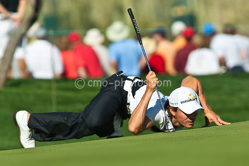 Feb 25, 2009; Marana, AZ, USA; Camilo Villegas (COL) reads the green on the 7th hole during a match against Rod Pampling (AUS-not pictured) during the first round of the World Golf Championships-Accenture Match Play Championship at the Ritz-Carlton Golf Club, Dove Mountain.