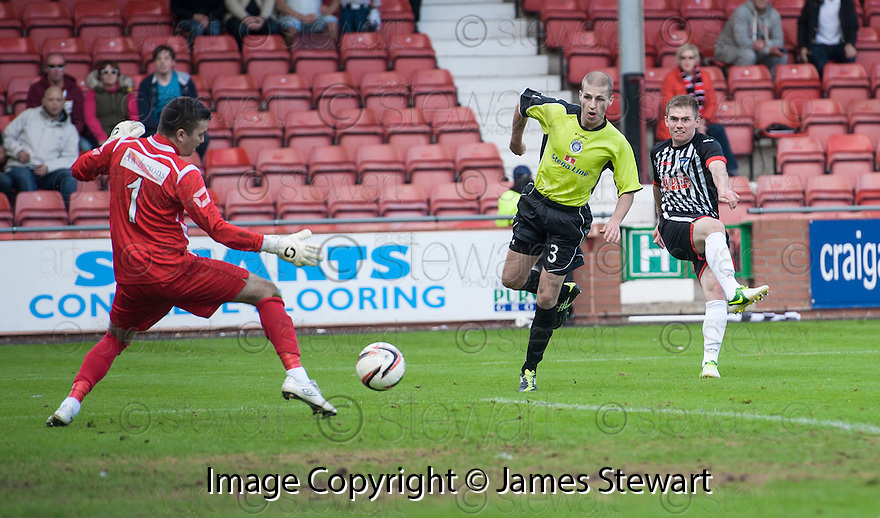 Pars' Allan Smith scores their third goal.