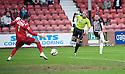 Pars' Allan Smith scores their third goal.
