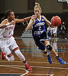 SIOUX FALLS MARCH 22:  Nicole Hampton #2 of Lubbock Christian drives past Sydni Payne #1 of Florida Southern during their quarterfinal game at the NCAA Women's Division II Elite 8 Tournament at the Sanford Pentagon in Sioux Falls, S.D. (Photo by Dick Carlson/Inertia)