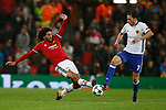 Marouane Fellaini of Manchester United (L) tackles Luca Zuffi of Basel during the Champions League Group A match at the Old Trafford Stadium, Manchester. Picture date: September 12th 2017. Picture credit should read: Andrew Yates/Sportimage