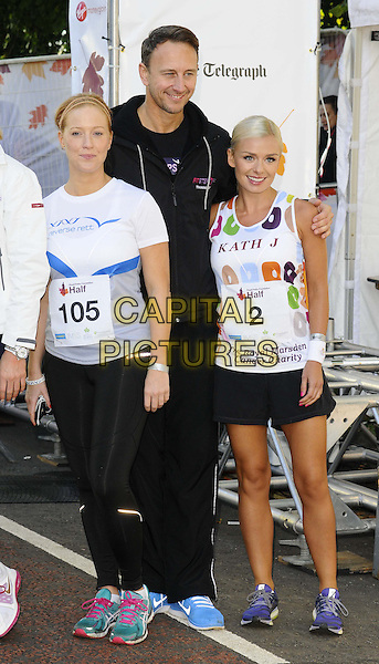 guest, Ian Waite &amp; Katherine Jenkins<br /> The Royal Parks Foundation Half Marathon, Hyde Park, London, England.<br /> October 6th, 2013<br /> full length blue shorts t-shirt white leggings   <br /> CAP/CAN<br /> &copy;Can Nguyen/Capital Pictures