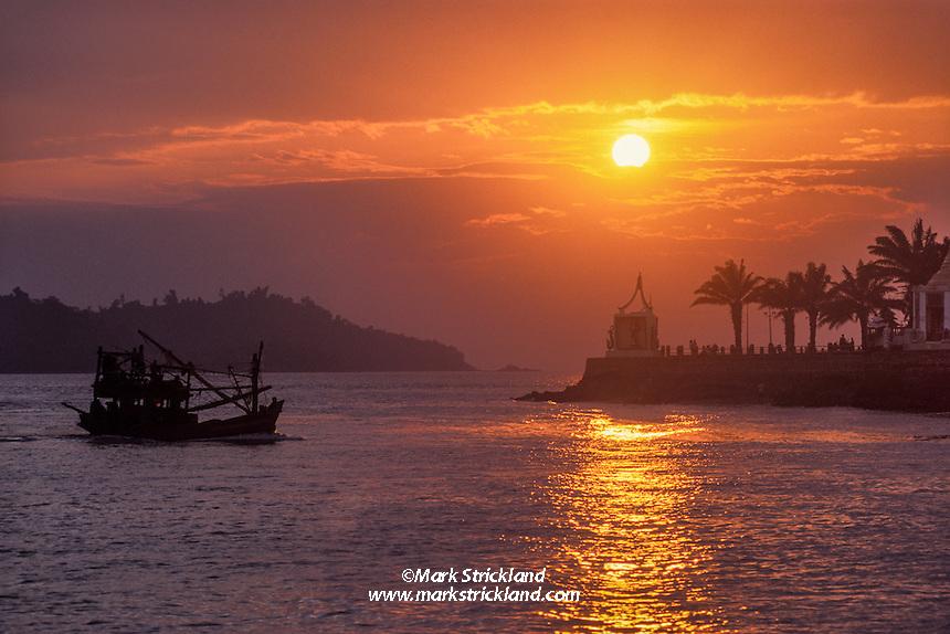 A fishing boat cruises along the waterfront at Kawthaung, a port town at the Thai / Burma border. Andaman Sea