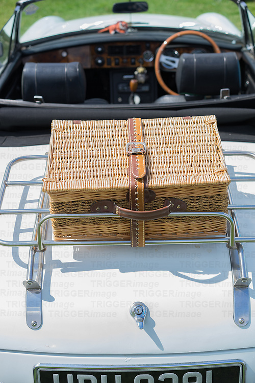 Close up of old MG cat with basket on luggage rack
