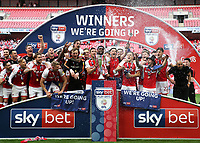 27th May 2018, Wembley Stadium, London, England;  EFL League 1 football, playoff final, Rotherham United versus Shrewsbury Town; Richard Wood of Rotherham United lifts the EFL League 1 play off trophy as they gain promotion to the Championship