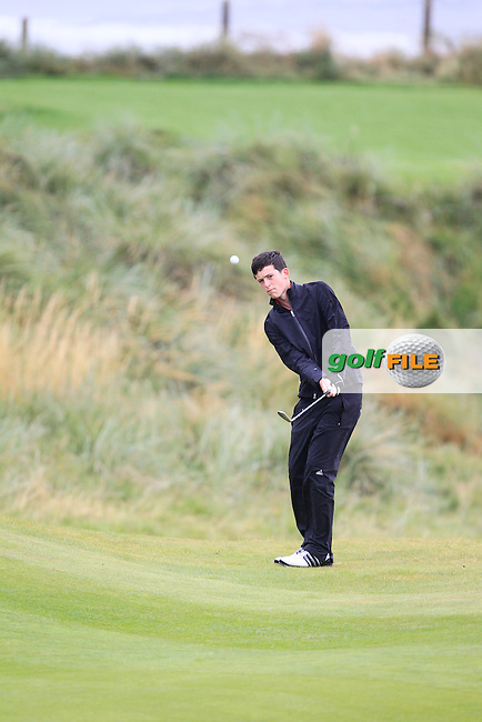Ryan McKinstry (Cairndhu) chipping onto the 3rd green during the South of Ireland Amateur Open Championship Semi-Finals at Lahinch Golf Club  31th July 2013 <br /> Picture:  Thos Caffrey / www.golffile.ie