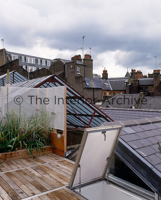 A hatch opens onto the decked roof garden with a view of the immediate neighbours