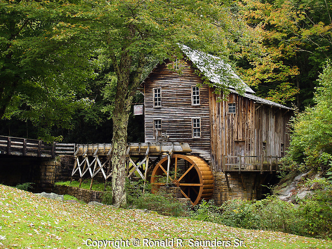 The Glade Creek Grist Mill is a new mill that was completed in 1976 at Babcock. Fully operable, this mill was built as a <br /> re-creation of one which once ground grain on Glade Creek long before Babcock became a state park. Known as Cooper's Mill, it stood on the present location of the park's administration building.<br /> (4)