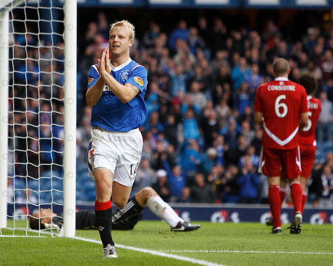 Steven Naismith knocks the rebound past David Gonzalez to score goal no 2 for Rangers and celebrates