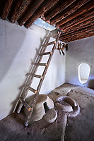 A clay oven below a ladder which led to the main entrance via the roof, which also allowed smoke out. A reconstruction of one of four Catalhoyuk houses to help archaeologists understand the finished structure of excavated ruins. 7500 BC to 5700 BC, Catalyhoyuk Archaeological Site, Çumra, Konya, Turkey
