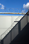 Barbed wire shadow on a gate