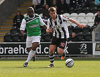 Paul McGowan chased by Pa Kujabi in the St Mirren v Hibernian Clydesdale Bank Scottish Premier League match played at St Mirren Park, Paisley on 29.4.12.