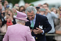 Arnaud M. Bamberger (Executive Chairman) at his final Cartier Polo event after 23 years is presented with an award by Her Majesty the Queen during the Cartier Queens Cup Final match between King Power Foxes and Dubai Polo Team at the Guards Polo Club, Smith's Lawn, Windsor, England on 14 June 2015. Photo by Andy Rowland.