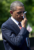 United States President Barack Obama wipes away perspiration during a ceremony to commemorate the 50th anniversary of the Vietnam War at the Vietnam Veterans Memorial in Washington, D.C. on Monday, May 28, 2012. .Credit: Kristoffer Tripplaar  / Pool via CNP